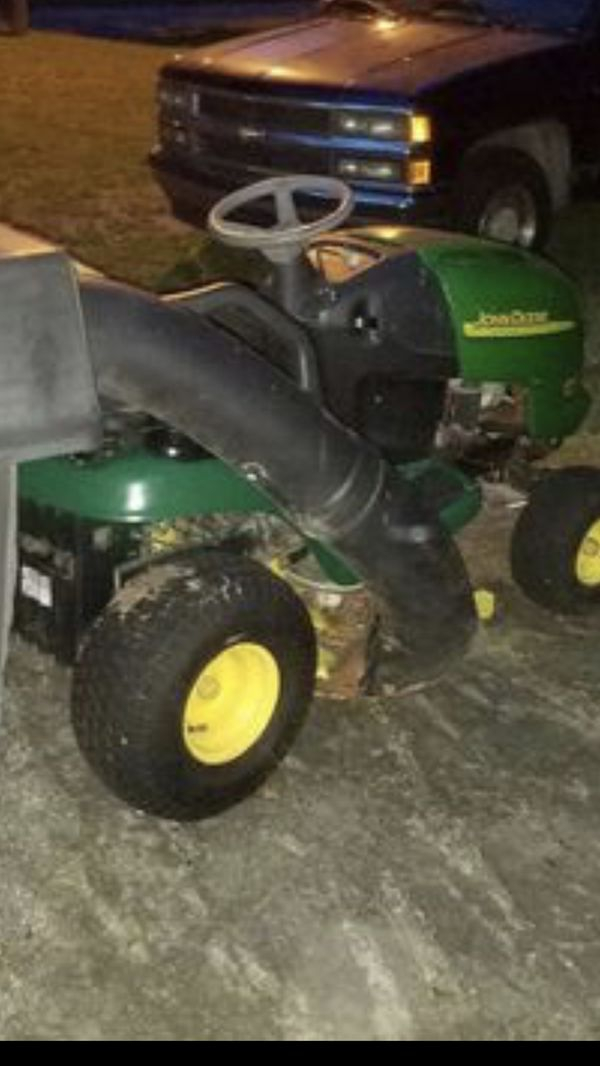 John Deere riding lawn mower with dual collection bags #look at this golf course cut!!!