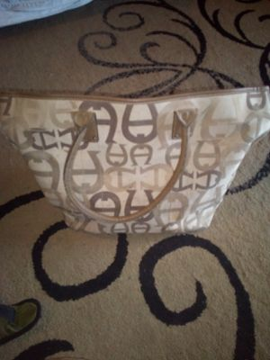 Big TANISH PURSE NAME BRAND ETIENNE AIGNER LOTS OF POCKETS AND ZIPPERS GIOD CONDITION ASKING ONLY $35 for Sale in Phoenix, AZ