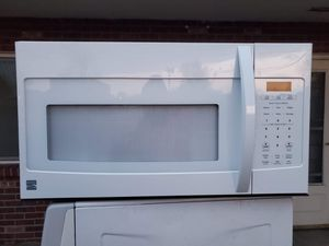 Kenmore white microwave good working conditions for $49 for Sale in Denver, CO