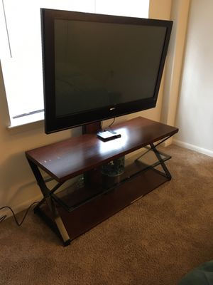 Tv, tv stand with roku for Sale in Baltimore, MD