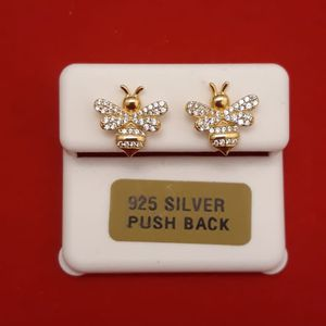Earrings 925 sterling silver with gold finish Icedout push back for Sale in Los Angeles, CA