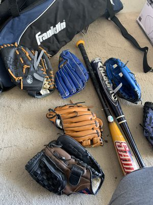 Baseball gloves and bats for Sale in Chula Vista, CA