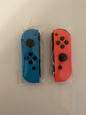 Brand new Nintendo switch joycon never used! Neon blue and neon red for Sale in Tampa, FL