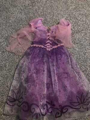 Disney rapunzel dress size5/6 for Sale in Conroe, TX