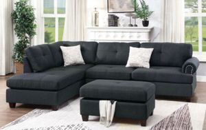 Ash black sectional sofa ( storage ottoman included) reversible chaise for Sale in Fullerton, CA
