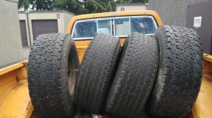 Tires and rims 6 lug 31x10.5R15 the front two and 32x11.5the back for Sale in Tacoma, WA