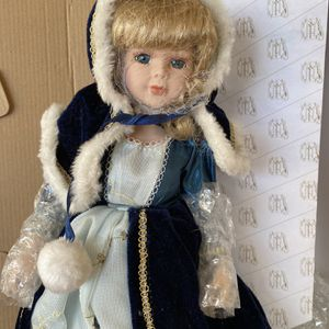Ceramic Doll New With 3 Outfits In A Box for Sale in St. Petersburg, FL