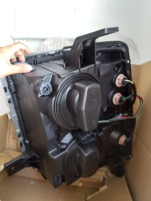 2015 Chevy Silverado headlights new never used still in the box asking $250 for Sale in Fresno, CA