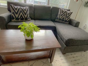 Sectional Couch (Reversible Chaise) & Coffee Table for Sale in Sanford,  FL