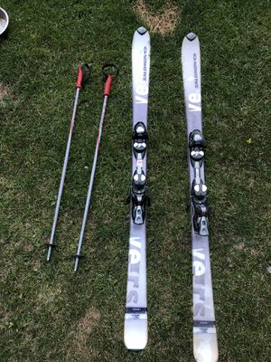 set of skis with poles,boots,helmet, and goggles for Sale in Mancelona, MI