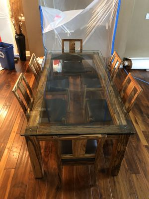 Glass top solid tiger wood base table for Sale in Tampa, FL