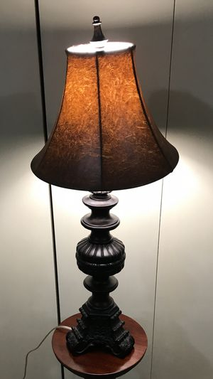 """Still available only one carved wood real leather shade table lamp 30"""" pick up Gaithersburg md20877 for Sale in Gaithersburg, MD"""