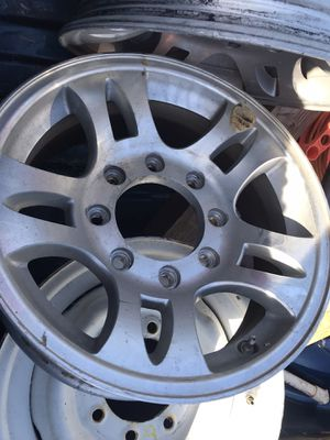 2 Aluminum 8 lug travel trailer wheels and 1 steel wheel for a spare for Sale in Grand Prairie, TX