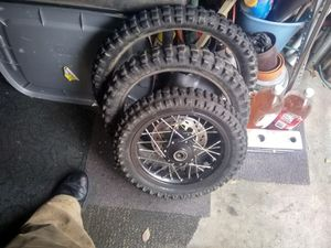 Dirt bike tires and 1 front wheel for Sale in Salt Lake City, UT