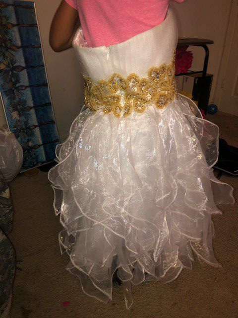 White short ruffle bottom flow dress with gold hand stich beading