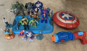 Action figures along with Captain America shield for Sale in Bellevue, WA