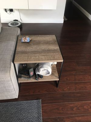 End table. Grey color wood with black metal frame for Sale in Fresno, CA