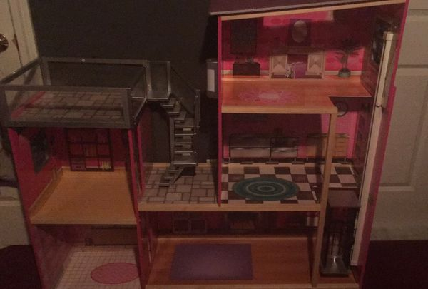 $120 doll house with elevator and pool