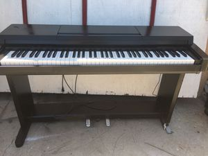 Vintage Yamaha clavinova with cop 250 with pedal piano . Works great . Just the stand it's not a good shape for Sale in Fontana, CA