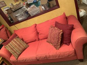 red couch with pillows and slipcover for Sale in Bellmore, NY