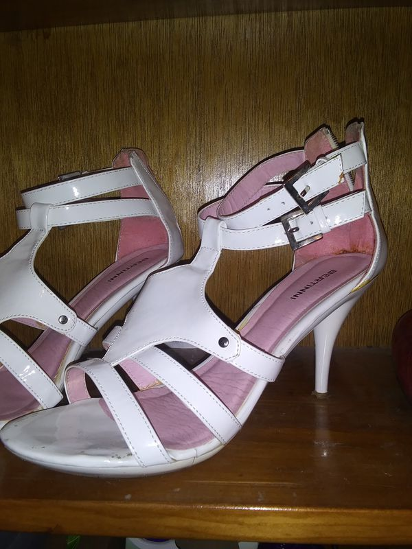 Women's white dress shoes with heels, needs cleaning size 8-1/2, heels are a little worn