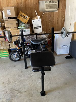 Olympic bar 7f and 80lbs Weight 2 inches and bench rack, use like new, pick up only for Sale in Ontario, CA