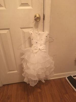 I have a flower girl dress size 2/4 worn once and two jr bridesmaids or can be flower girl/graduation dresses size 14(tag still on) and size 10(worn for Sale in Atlanta, GA