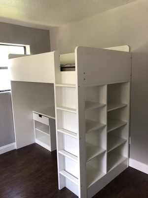 Kids bed with desk and shelves for Sale in Orlando, FL