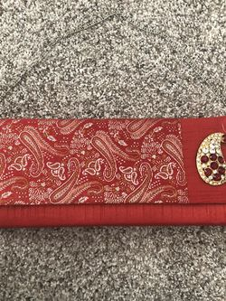 Small Red Clutch With Brooch for Sale in Littleton,  CO