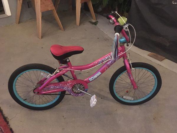Pink Schwinn kids bike
