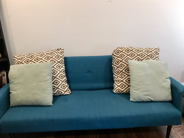 Teal Convertible Futon (Pick Up this Weekend)