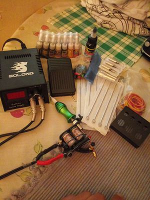 Tattoo gun w/ power supply foot pedal new needles and 15 new ink bottles for Sale in San Jose, CA