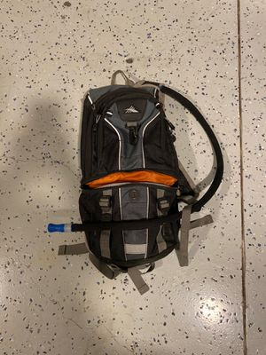 High Sierra Light Weight Hiking backpack With thermal vest on water tube. for Sale in Fort Worth, TX