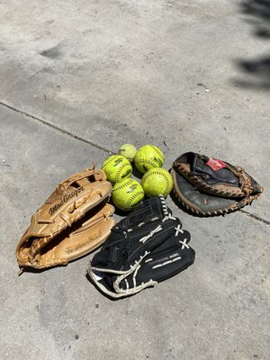 Baseball gloves and softballs for Sale in Simi Valley, CA