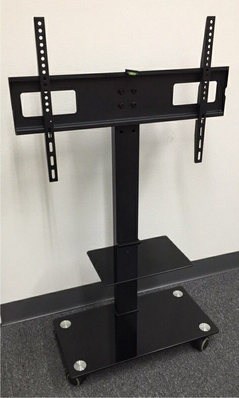 Brand new in box TV stand on wheels universal fits 32 to 65 Inch TV sizes flat screen LCD plasma