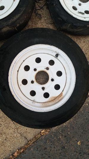 Three 5 lug trailer wheels only one tire is good for Sale in Dallas, TX
