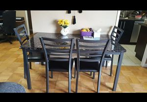 Ashleys dining table with four chairs for Sale in New York, NY