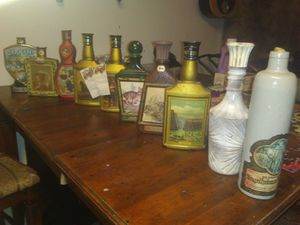 Large vintage antique bottle and glass jar collection jim beam log cabin etc for Sale in Phoenix, AZ
