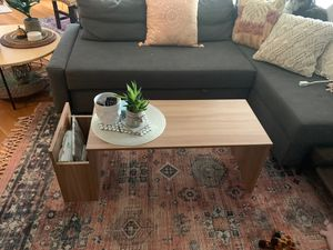Brand new coffee table w side pocket magazine or book storage ^* avail for pick up aug 18- 20th walnut color great perfect condition** for Sale in Columbus, OH