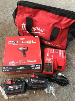 Milwaukee impact wrench 1400 torque with batteries charger and bag for Sale in Lemont, IL