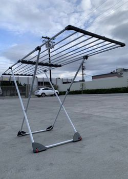 """Brand New 35"""" tall foldable adjustable expandable from 41"""" to 72"""" steel plastic built in garment grip air drying delicate rolling rear wheel clothes for Sale in Los Angeles,  CA"""