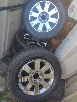 Rims & tires 30% 265/65R18 good condition except 1rim has rust inside loose some air can be fix I have the covers too. ( no sensors)from Lincoln 06 for Sale in Modesto, CA