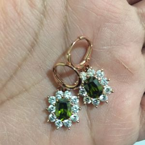 Rose gold plated cz dangles earrings for Sale in Silver Spring, MD