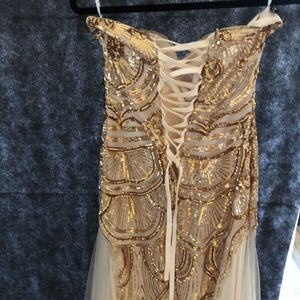 Gold sequin dress for prom or turn about has a tie in the back and is beautiful for Sale in Austin, TX