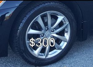 2007 g35x 17 inch factory rims with new cooper tir for Sale in Cranston, RI