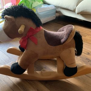 Like Brand New. Pony land 24 Inches Brown Rocking Horse With Riding Sound (retail $66) for Sale in Miami, FL