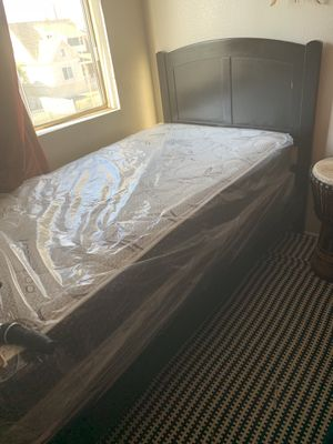 Twin bed brand new still in bag both Mattress and box spring. headboard Etc. If you are interested you pick it up. Thank you. for Sale in Long Beach, CA