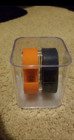 FitBit w/ two different bands, display case, and charger for Sale in Holly Springs, NC