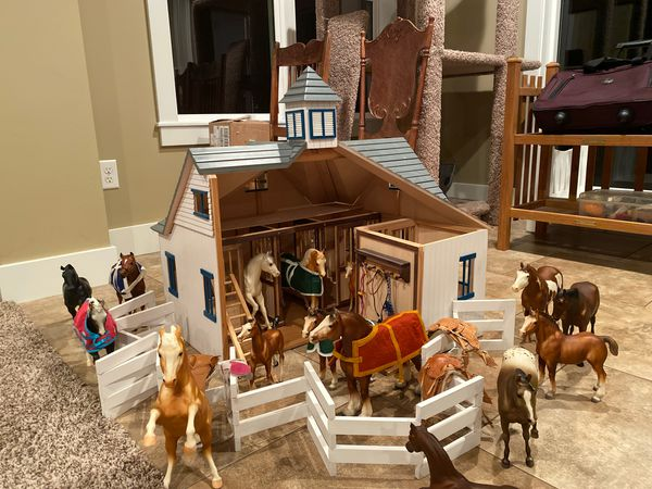 Fabulous Wooden horse barn with moving doors on the stalls and to the barn it's self… This also comes with horse blankets horse saddles bridals and 1