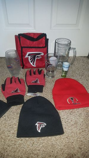 2 Atlanta Falcons beanies with tag on 1. XL-L gloves, Falcons glass, insulated lunch bag, XL beer mug, football shaped glass, Atlanta shot glass. for Sale in Deerfield Beach, FL